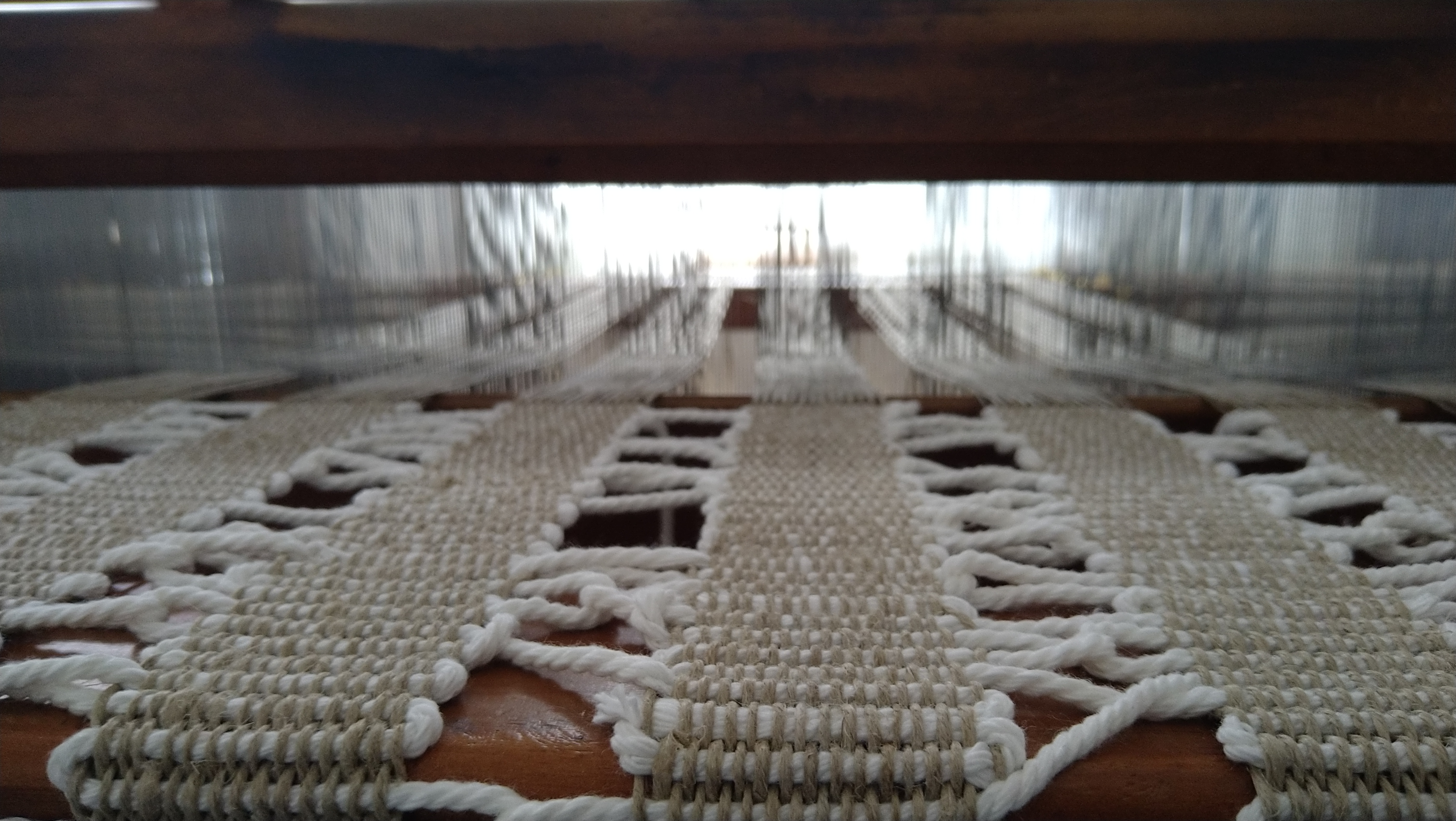 Information flows - close up of handweaving on the loom