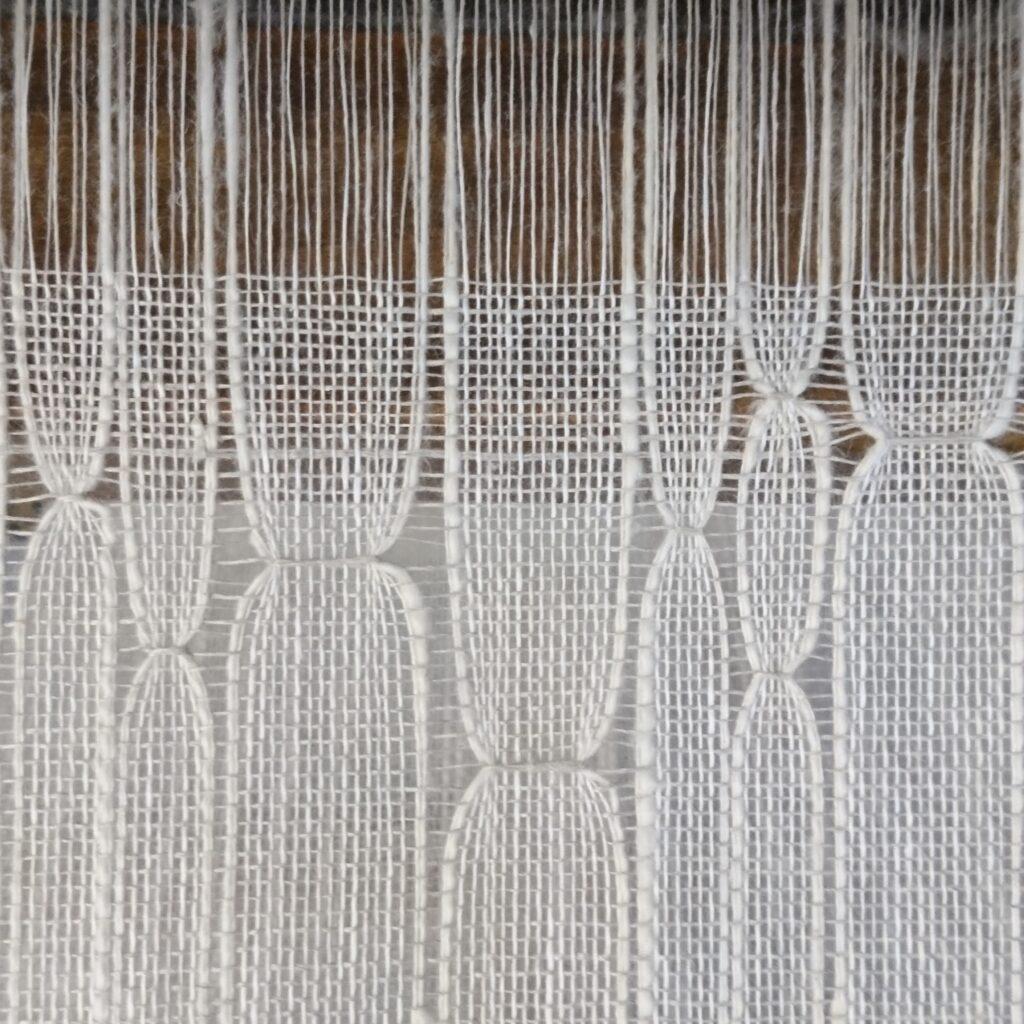 Exploring ancestral identity through weaving - handwoven fabric visualising genetic information.